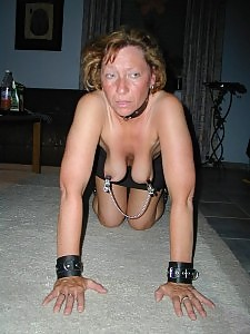 Mature slut in heavy bondage